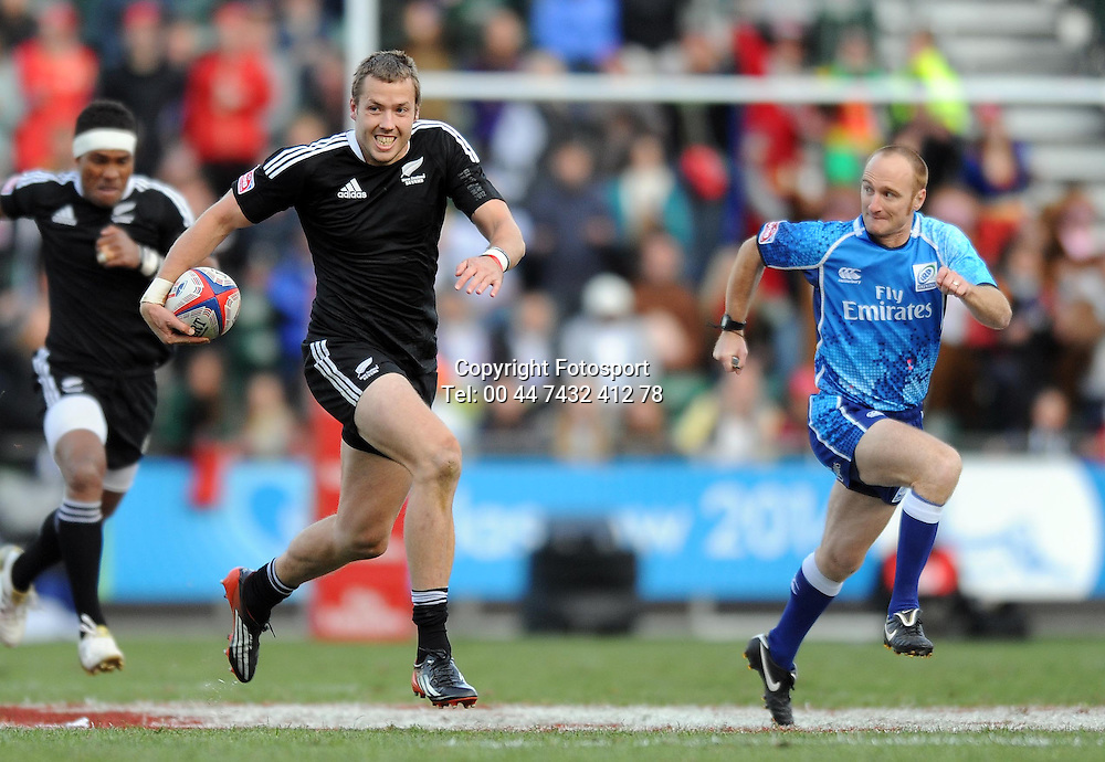 New Zealand's Tom Mikkelson breaks upfield with the referee for company.<br /> New Zealand v England, Cup Final, IRB Sevens World Series, round 8, Day 2, Scotstoun Stadium, Glasgow, Scotland, Sunday 6th May 2012.<br /> PLEASE CREDIT ***FOTOSPORT/DAVID GIBSON***
