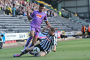 Notts County defender Gill Swerts tackles Plymouth Argyle forward Jake Jervis  during the Sky Bet League 2 match between Notts County and Plymouth Argyle at Meadow Lane, Nottingham, England on 11 October 2015. Photo by Simon Davies.