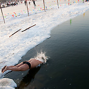 Swimming in Frozen Houhai Lake in Beijing