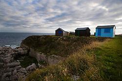 Holiday sheds along the cliff edge, Portland, Dorset, England, UK.