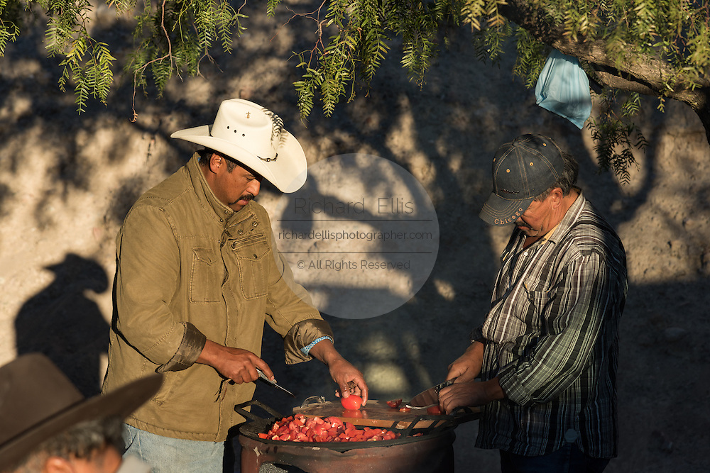 Mexican cowboys prepare breakfast in camp on Cubilete Mountain at the start of the final day during the annual Cabalgata de Cristo Rey pilgrimage January 6, 2017 in Guanajuato, Mexico. Thousands of Mexican cowboys and horse take part in the three-day ride to the mountaintop shrine of Cristo Rey.