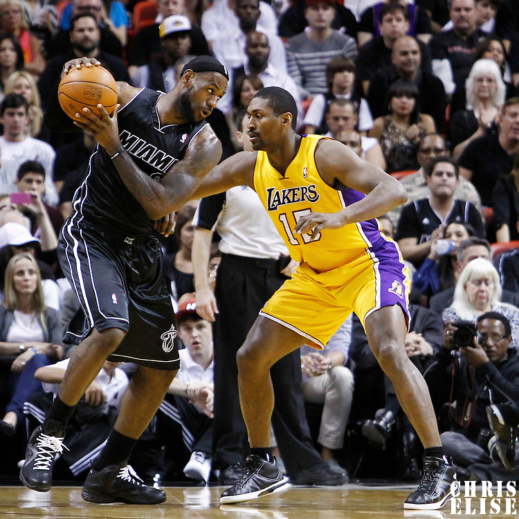19 January 2012:  Los Angeles Lakers small forward Metta World Peace (15) defends on Miami Heat small forward LeBron James (6) during the Miami Heat 98-87 victory over the Los Angeles Lakers at the AmericanAirlines Arena, Miami, Florida, USA.