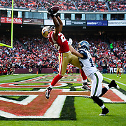 San Francisco 49ers cornerback Nate Clements intercepts a pass intended for Seattle Seahawks wide receiver Brandon Stokley at Candlestick Park in San Francisco, California.