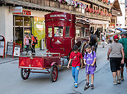 Zermatt street scene: horse-drawn carriage with trailer, Switzerland, the Alps, Europe.