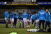 Forest Green Rovers players warm up during the Vanarama National League match between Sutton United and Forest Green Rovers at Gander Green Lane, Sutton, United Kingdom on 14 March 2017. Photo by Adam Rivers.