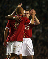 Photo: Paul Thomas.<br /> Manchester United v Europe XI. Friendly match. 13/03/2007.<br /> <br /> Goal scorer Wes Brown (6) of Utd is congratulated by Wayne Rooney.