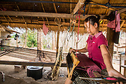 15 MARCH 2013 - BAN DAN NGUYEN:  A woman works at a loom near her home in the village of Ban Dan Nguyen.  PHOTO BY JACK KURTZ