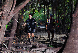 """© Licensed to London News Pictures. 11/10/2013. BRAZIL. Athletes running through dense amazon jungle. Competitors take part in the Jungle Marathon 2013, the """"The toughest ultra marathon in the world"""" The race is 245 km long through the biggest jungle in the world, The Amazon. It attracts competitors from all countries world wide. Competitors run through territories of indigenous tribes throughout the 7 day race, where they stay with them as guests.. Photo credit : Alexander Beer/LNP"""