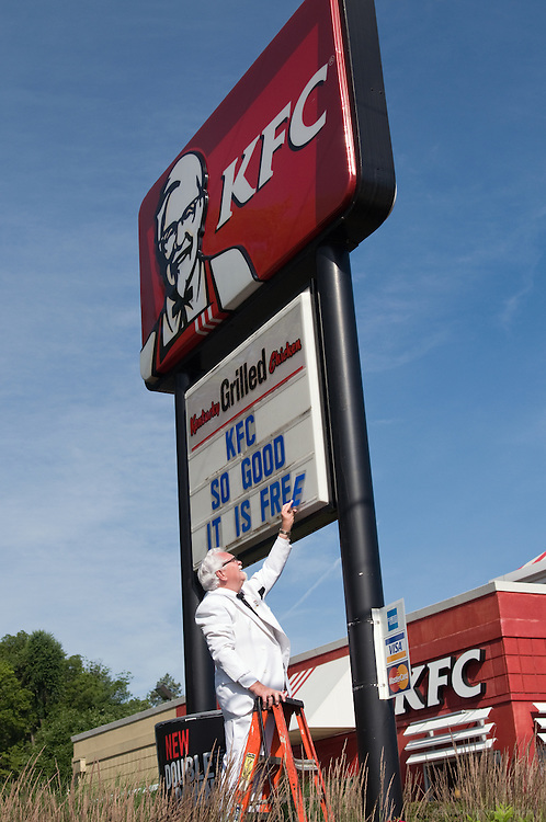 EMBARGOED UNTIL 8:00 A.M., MONDAY JUNE 14, 2010--This handout photo from KFC shows the KFC Colonel, Bob Thompson, changing the reader board to say 'KFC So good it is free,' Thursday, June 10, 2010 in Louisville, Ky. KFC's cooking up a free food giveaway for the brand's fans in 50 restaurants across all 50 states on June 17. (Photo by Brian Bohannon).