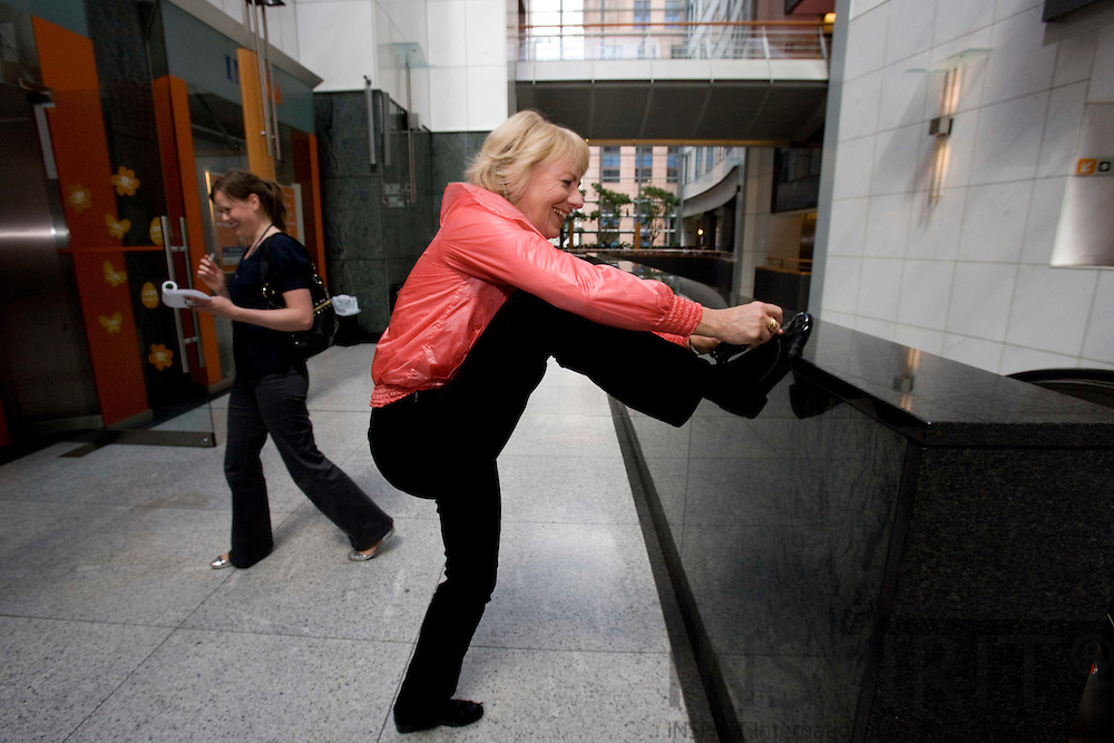 BRUSSELS - BELGIUM - 18 MAY 2009 -- Danish MEP Karin RIIS-JØRGENSEN (Jorgensen) making her shoelace on the move in the EU Parliament. Photo: Erik Luntang