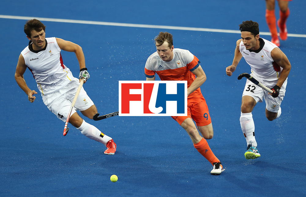 RIO DE JANEIRO, BRAZIL - AUGUST 16:  Seve van Ass of the Netherlands breaks with the ball during the Men's semi final hockey match between Belgium and the Netherlands on Day 11 of the Rio 2016 Olympic Games held at the Olympic Hockey Centre on August 16, 2016 in Rio de Janeiro, Brazil.  (Photo by David Rogers/Getty Images)