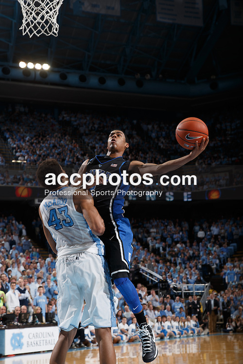CHAPEL HILL, NC - MARCH 09: Quinn Cook #2 of the Duke Blue Devils scores over James Michael McAdoo #43 of the North Carolina Tar Heels on March 09, 2013 at the Dean E. Smith Center in Chapel Hill, North Carolina. Duke won 69-53. (Photo by Peyton Williams/UNC/Getty Images) *** Local Caption *** Quinn Cook;James Michael McAdoo