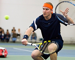 Virginia's Lee Singer hits a backhand volley in #3 doubles against VT.   The #1 ranked Virginia Cavaliers faced the #31 ranked Virginia Tech Hokies in NCAA Men's Tennis at the Boar's Head Sports Club in Charlottesville, VA on February 27, 2009.