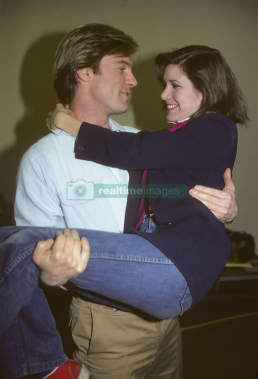 CARRIE FRANCES FISHER (October 21, 1956 - December 27, 2016) the actress best known as Star Wars' Princess Leia Organa, has died after suffering a heart attack. She was 60. Pictured: October 15, 1980 - New York, New York, U.S. - Carrie Fisher with Stephen Collins (Credit Image: © Lynn Goldsmith via ZUMA Press)