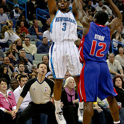 Dec 16, 2009; New Orleans, LA, USA;  New Orleans Hornets guard Chris Paul (3) shoots over Detroit Pistons guard Will Bynum (12) during the first half at the New Orleans Arena. Mandatory Credit: Derick E. Hingle-US PRESSWIRE