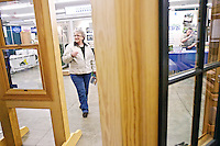 Rita Amende does some window shopping at the Sierra Pacific Windows booth Friday at the North Idaho Building Contractors Association Home & Garden Show.