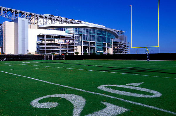 Stock photo of the exterior view of Reliant Stadium from the twenty yard line of the adjacent practice field