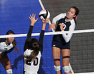 Sioux City Bishop Heelan's Katelyn Walsh (10) tries to get the ball past Mount Vernon's Ali Stark (20) during the first game of a 3A semifinal in the state volleyball tournament at the U.S. Cellular Center at 370 1st Ave E on Friday afternoon, November 12, 2010. (Stephen Mally/Freelance)