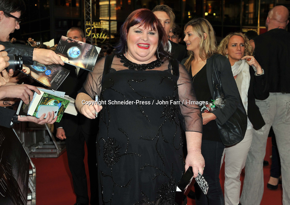Cassandra Clare arrives for the 'The Mortal Instruments: City of Bones' Germany premiere at Sony Centre on Tuesday August 20, 2013 in Berlin, Germany. Photo by Schneider-Press / John Farr / i-Images. <br /> UK &amp; USA ONLY