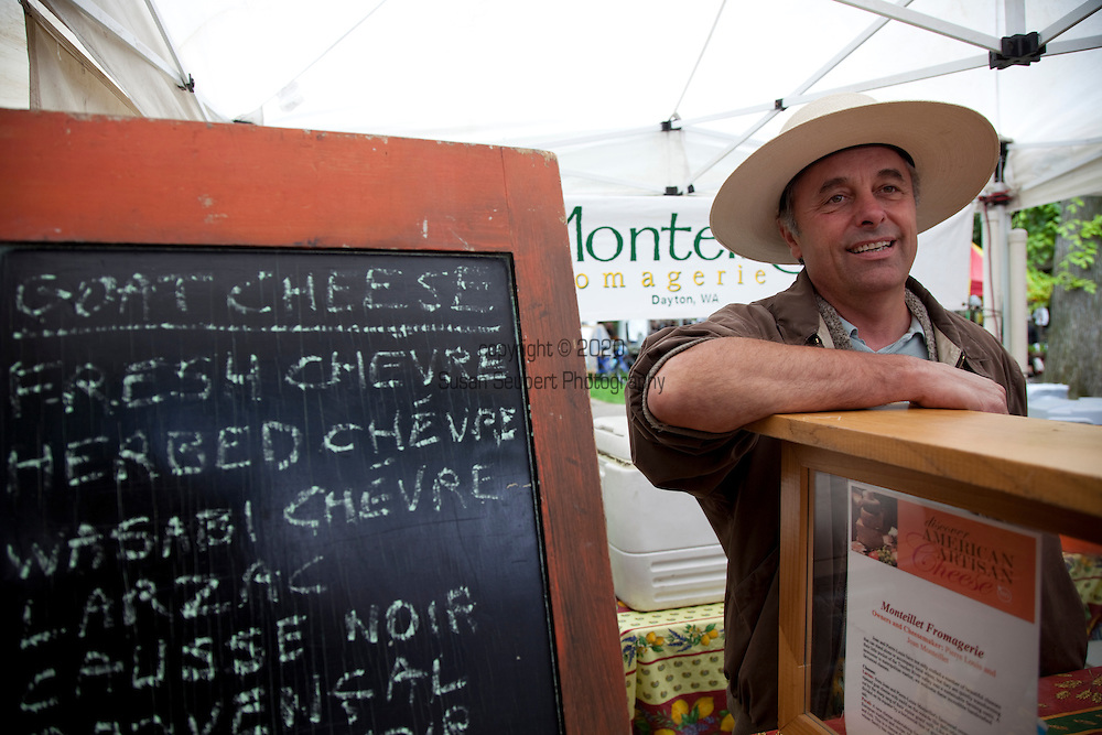 The extremely popular Saturday Portland Farmers' Market, located in the South Park Blocks near the Portland State University Campus, offers a large selection of locally grown organic produce, fish, meat and foodstuffs.  Pictured here Pierre-Louis Monteillet who runs Monteillet Fromagerie in Dayton, WA.