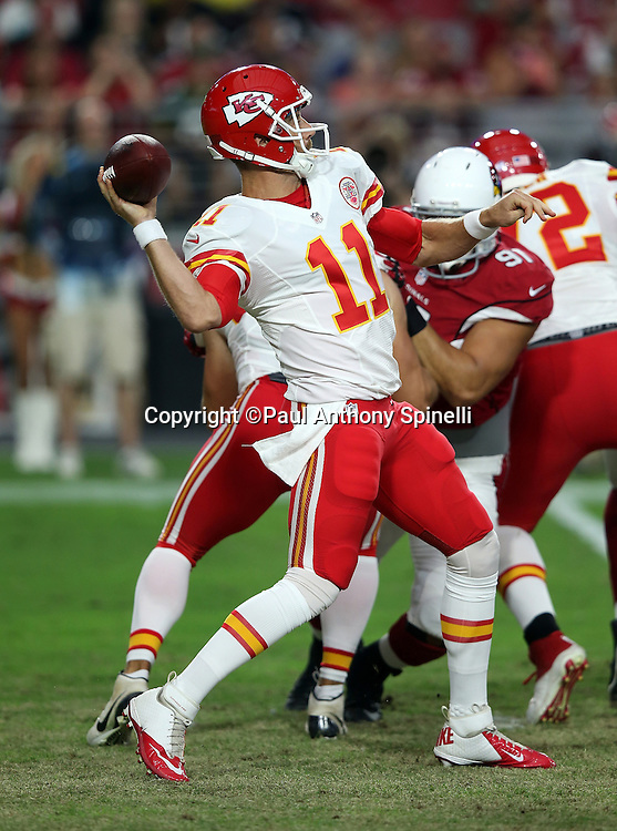 Kansas City Chiefs quarterback Alex Smith (11) throws a deep pass in the first quarter during the 2015 NFL preseason football game against the Arizona Cardinals on Saturday, Aug. 15, 2015 in Glendale, Ariz. The Chiefs won the game 34-19. (©Paul Anthony Spinelli)