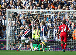 WEST BROMWICH, ENGLAND - Saturday, August 18, 2012: Liverpool's goalkeeper Jose Reina saves a penalty kick from West Bromwich Albion's Shane Long during the opening Premiership match of the season at the Hawthorns. (Pic by David Rawcliffe/Propaganda)