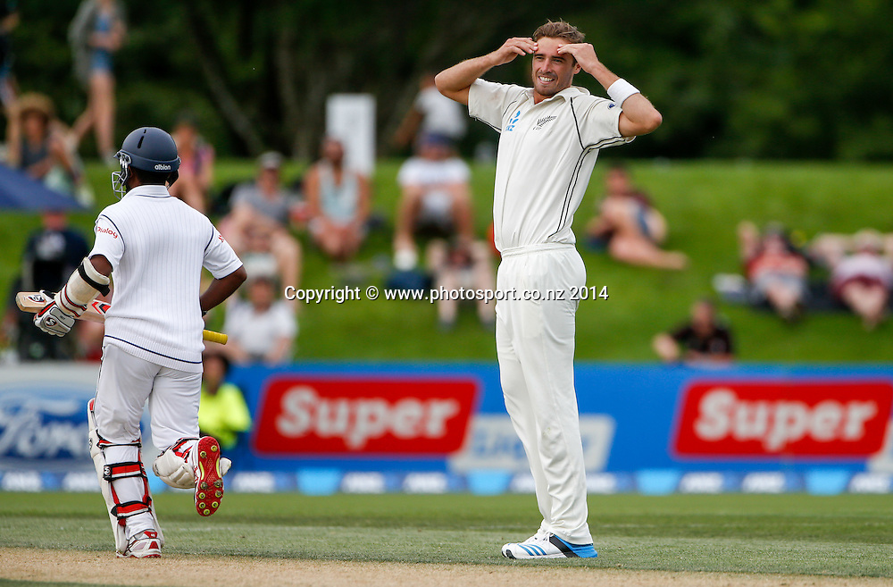 Tim Southee reacts to a missed chance. Day 2, ANZ Boxing Day Cricket Test, New Zealand Black Caps v Sri Lanka, 27 December 2014, Hagley Oval, Christchurch, New Zealand. Photo: John Cowpland / www.photosport.co.nz