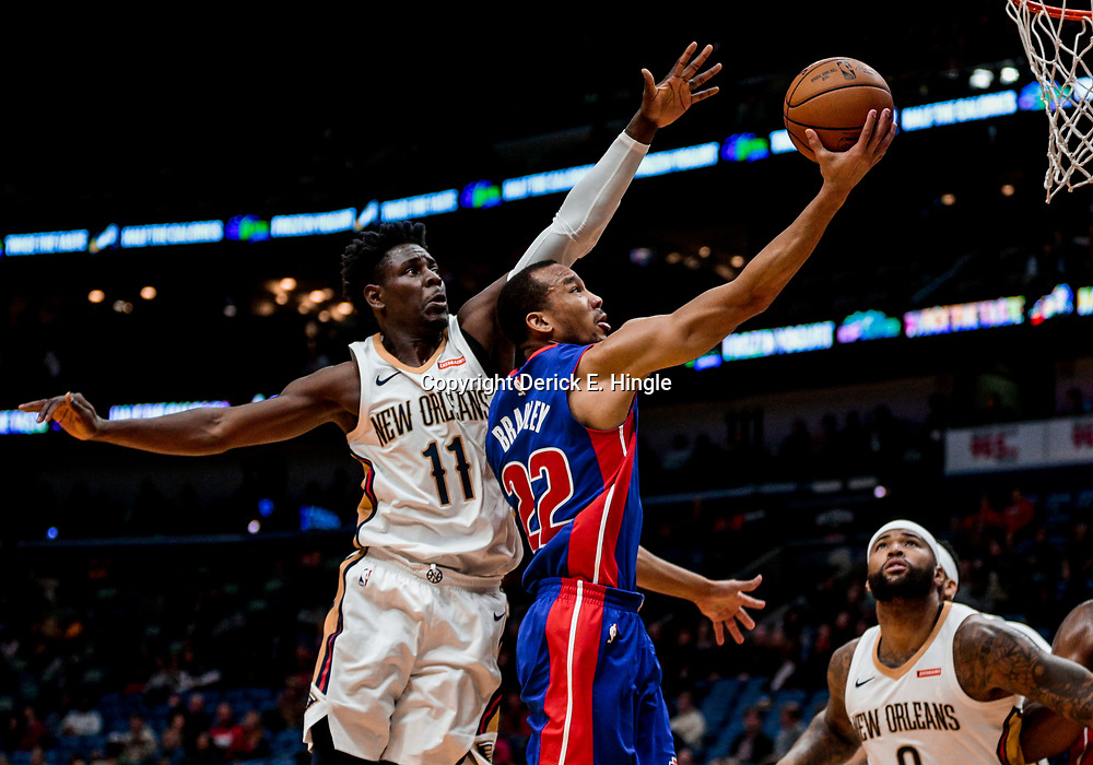 Jan 8, 2018; New Orleans, LA, USA; Detroit Pistons guard Avery Bradley (22) shoots over New Orleans Pelicans guard Jrue Holiday (11) and center DeMarcus Cousins (0) during the first quarter at the Smoothie King Center. Mandatory Credit: Derick E. Hingle-USA TODAY Sports