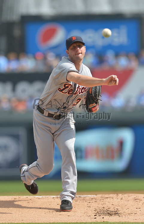 Sep 20, 2014; Kansas City, MO, USA; Detroit Tigers starting pitcher Max Scherzer (37) delivers a warm up pitch before the game against the Kansas City Royals at Kauffman Stadium. Detroit won 3-2. Mandatory Credit: Denny Medley-USA TODAY Sports