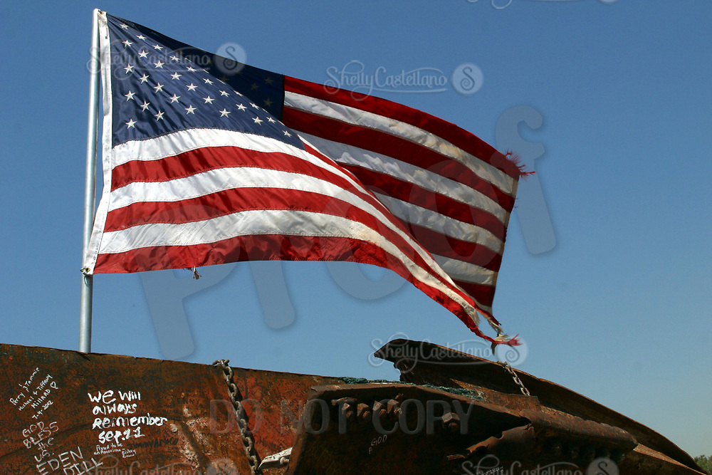 Sep 10, 2002; Yorba Linda, California, USA; American Flag flys over an exhibit of 9/11 wreckage from the World Trade Center at the Richard Nixon Library &amp; Birthplace.<br />