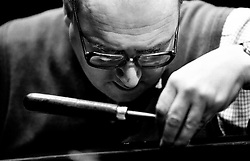 Piano tuner Paul Chrimes, a member of the Association of Blind Piano Tuners, working on an instrument at the Grand Theatre, Wolverhampton, England, UK.