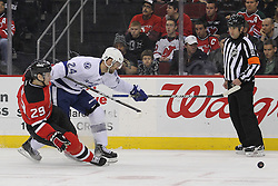 Mar 29; Newark, NJ, USA; Tampa Bay Lightning left wing Trevor Smith (24) and New Jersey Devils defenseman Mark Fayne (29) battle for the loose puck during the second period at the Prudential Center.