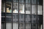 office high rise windows with boxes and paperwork