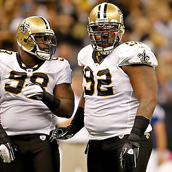 October 23, 2011; New Orleans, LA, USA; New Orleans Saints defensive tackle Shaun Rogers (92) and New Orleans Saints defensive tackle Sedrick Ellis (98) against the Indianapolis Colts during the first quarter of a game at the Mercedes-Benz Superdome. Mandatory Credit: Derick E. Hingle-US PRESSWIRE / © Derick E. Hingle 2011