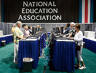 San Diego,CA- NATIONAL EDUCATION ASSOCIATION- Michael Chaffee,left of Nebraska checks his e-mail in the e-mail center at the 147th Annual meeting.( Photo/ Scott Iskowitz/ RA TODAY)