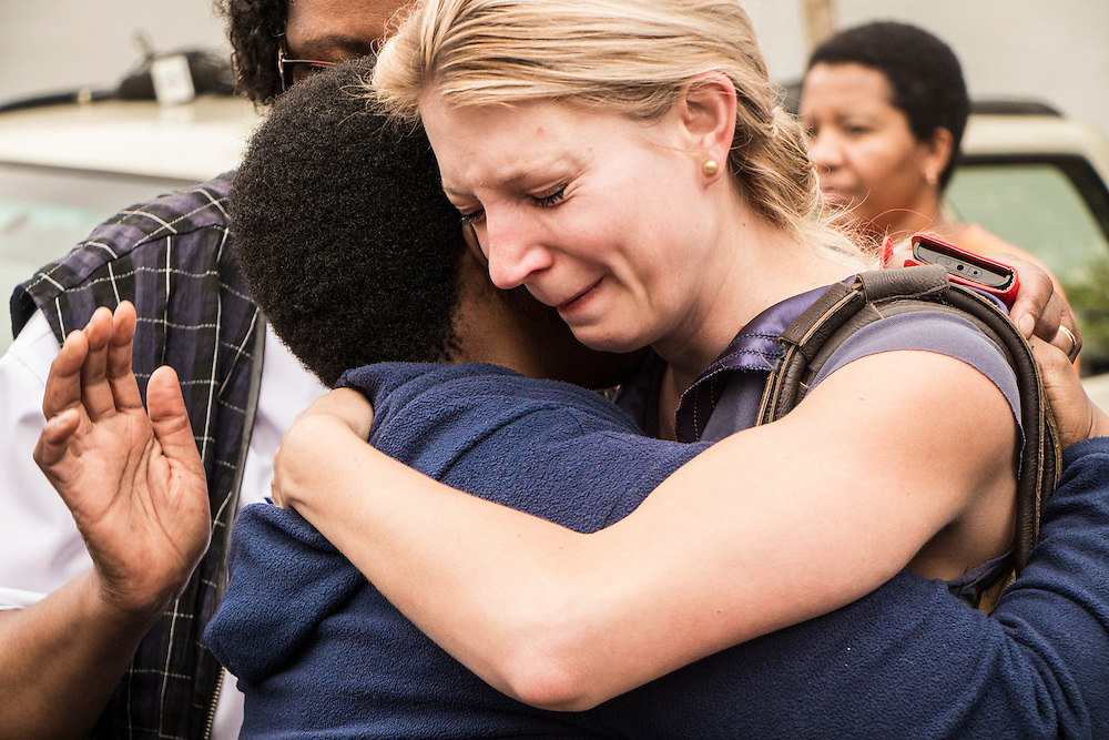 Two South African women console each other after the announcement of Nelson Mandela's death outside his Houghton house, on Friday Dec.6 2013.