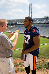 "Virginia Cavaliers LB Jermaine Dias (57) is interviewed by the media...The Virginia Cavaliers football team held their annual ""Meet the Team"" event at Scott Stadium in Charlottesville, VA on August 12, 2007.  The event was open to the public and gave fans the opportunity to meet the players on the team and get their autographs."