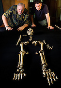 "Dr. William Jungers and Matthew Tocheri admire ""LB1"", the type specimen skeleton of Homo floresiensis, a.k.a., the Flores hobbit."
