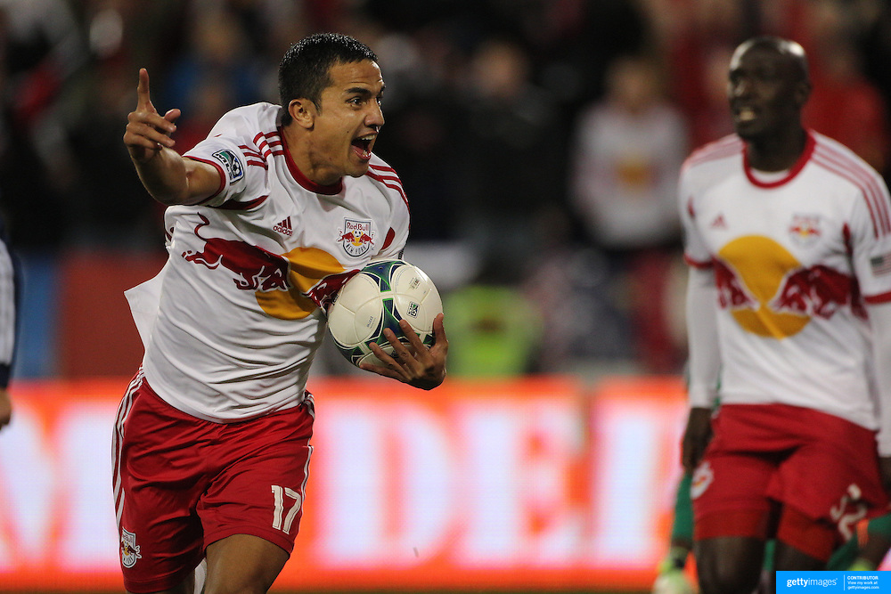 Tim Cahill, (left), New York Red Bulls, celebrates his sides second goal after combing with team mate Ibrahim Sekagya, (right), to force the ball into the net during the New York Red Bulls V Chicago Fire, Major League Soccer regular season match at Red Bull Arena, Harrison, New Jersey. USA. 27th October 2013. Photo Tim Clayton