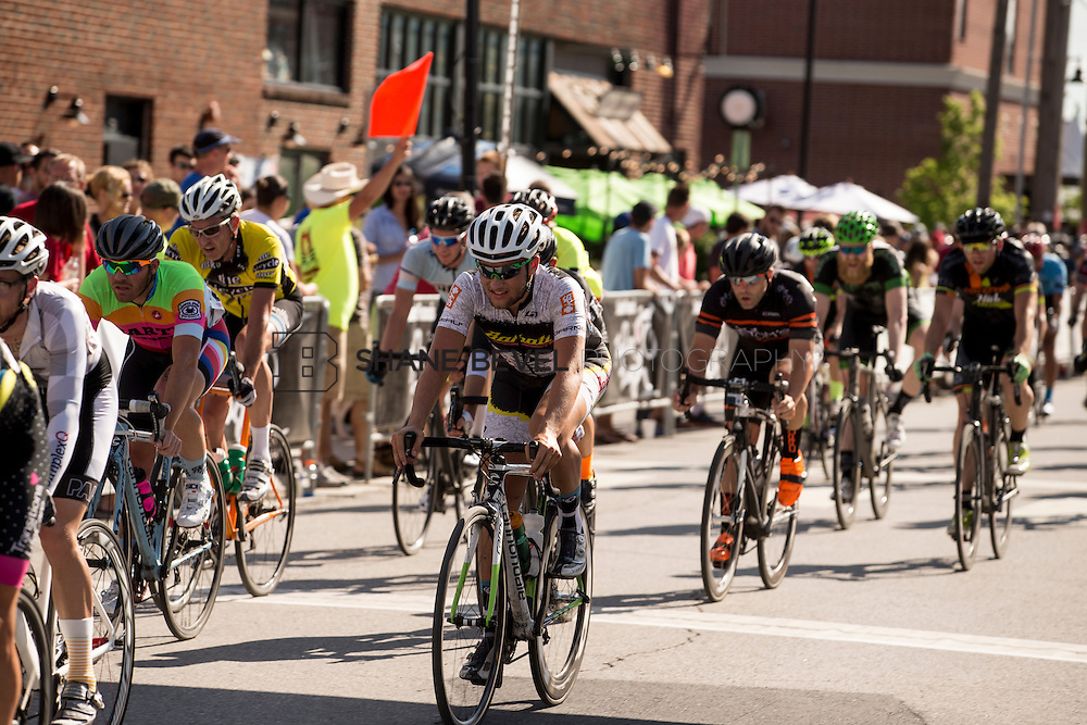 6/13/15 5:18:12 PM -- Racers pass by the crowds in the criterium races in the Brady Arts District on Saturday afternoon of Tulsa Tough. <br /> <br /> Photo by Shane Bevel