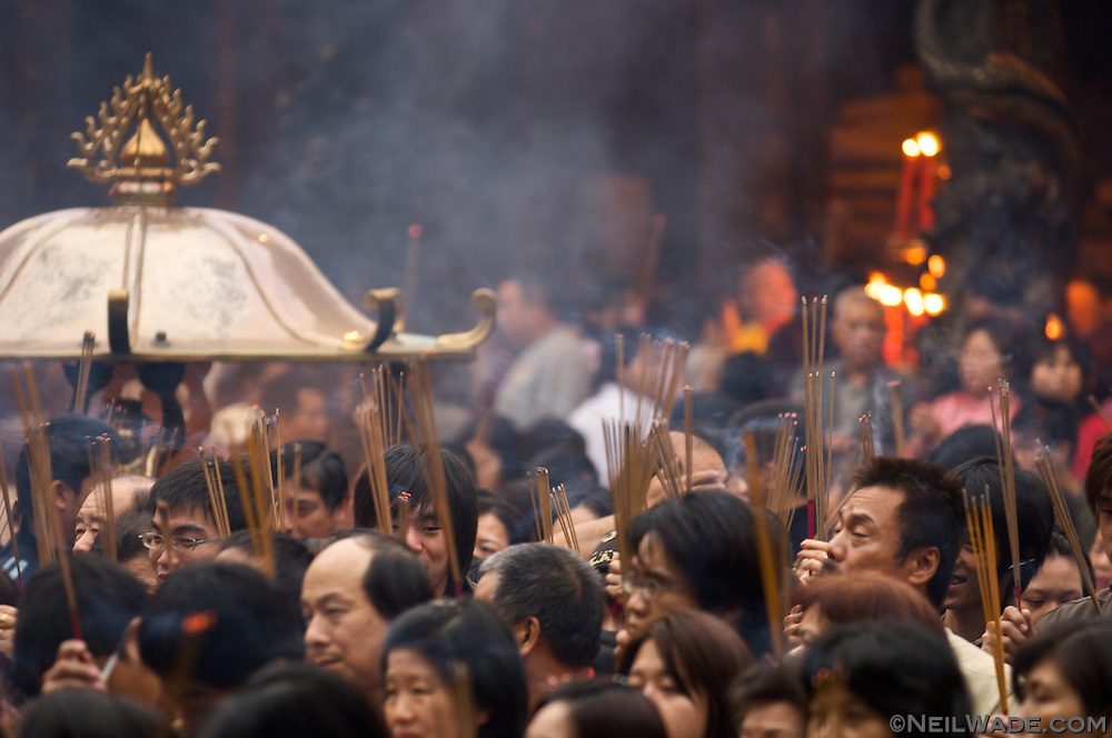 Praying at Lungshan Daoist Temple in Taipei, Taiwan is considered to be very lucky on the first day of Chinese Lunar New Year.  Many people burn incense as they pray to the various dieties of the temple.