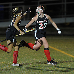 TOM KELLY IV &mdash; DAILY TIMES<br /> Carroll's Grace McClatchy (20) celebrates her first goal with Keara McNulty (7) during the Philadelphia Catholic League Championship Field Hockey match between Archbishop Carroll and Cardinal O'Hara which was held Thursday night October 30, 2014 at Neumann University.