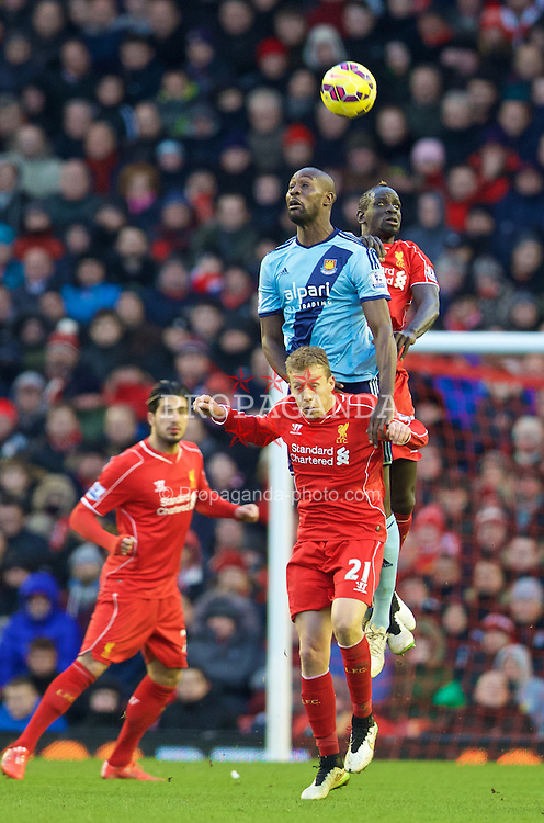 LIVERPOOL, ENGLAND - Saturday, January 31, 2015: Liverpool's Mamadou Sakho and Lucas Leiva in action against West Ham United's Carlton Cole during the Premier League match at Anfield. (Pic by David Rawcliffe/Propaganda)