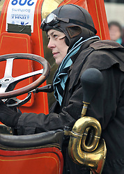 ©London News pictures...07/11/2010. A woman starts her car on a freezing morning in Crawley as Pre 1905 four-wheeled cars, tricars and motor tricycles take part in the 77th London to Brighton Veteran Car Run (LBVCR). Representing 24 nations, 572 entries were received for this year's LBVCR, the world's longest running motoring event