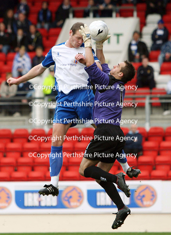 St Johnstone v Queen of the South....20.10.07<br /> Kenny Deuchar outjumps Jamie McDonald to open the scoring<br /> Picture by Graeme Hart.<br /> Copyright Perthshire Picture Agency<br /> Tel: 01738 623350  Mobile: 07990 594431
