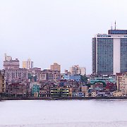 Skyline of Havana shows the Habana Libre Hotel, formerly the Habana Hilton before it was nationalized by the Castro government in 1960. Buildings mostly in disrepair is home to a lot of Cubans in Havana. Some buildings are improved as the economic situation improves.