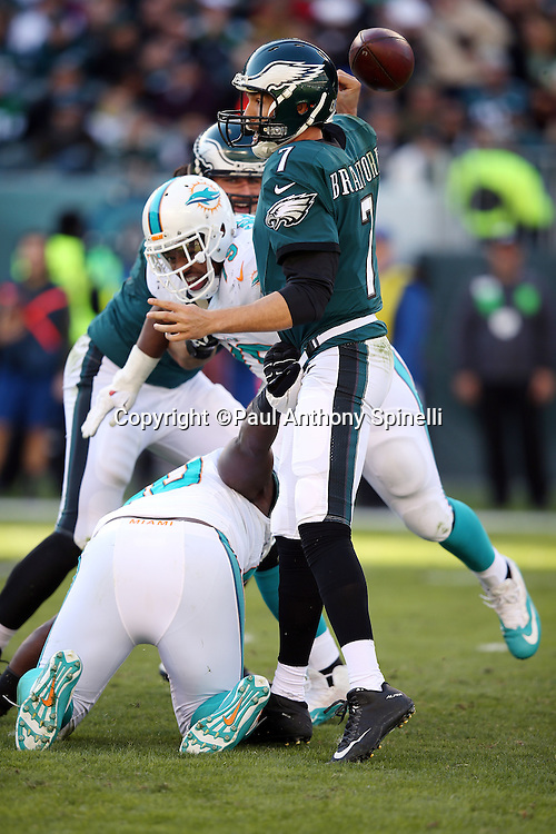 Philadelphia Eagles quarterback Sam Bradford (7) sack fumbles the ball on a second quarter hit by Miami Dolphins defensive tackle Earl Mitchell (90) for a loss of 24 yards to the Eagles 3 yard line, forcing a punt, during the 2015 week 10 regular season NFL football game against the Miami Dolphins on Sunday, Nov. 15, 2015 in Philadelphia. The Dolphins won the game 20-19. (©Paul Anthony Spinelli)