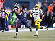 Seattle Seahawks wide receiver Doug Baldwin (89) catches a 35 yard pass in overtime that gives the Seahawks a first down at the Green Bay Packers 35 yard line as he gets chased by Green Bay Packers cornerback Casey Hayward (29) during the NFL week 20 NFC Championship football game against the Green Bay Packers on Sunday, Jan. 18, 2015 in Seattle. The Seahawks won the game 28-22 in overtime. ©Paul Anthony Spinelli