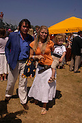 Oliver and Arabella Tobias with their son Luke. Veuve Clicquot Gold Cup Final at Cowdray Park. Midhurst. 17 July 2005. ONE TIME USE ONLY - DO NOT ARCHIVE  © Copyright Photograph by Dafydd Jones 66 Stockwell Park Rd. London SW9 0DA Tel 020 7733 0108 www.dafjones.com