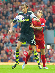 17.08.2013, Anfield, Liverpool, ENG, Premier League, FC Liverpool vs Stoke City, 1. Runde, im Bild Liverpool's Daniel Agger and Stoke City's Peter Crouch during the Premiership match at Anfield during the English Premier League 1st round match between Liverpool FC and Stoke City FC at Anfield, Liverpool, Great Britain on 2013/08/17. EXPA Pictures © 2013, PhotoCredit: EXPA/ Propagandaphoto/ David Rawcliffe<br /> <br /> ***** ATTENTION - OUT OF ENG, GBR, UK *****